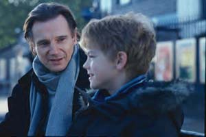 Liam Neeson with the impossibly cute Thomas Sangster
