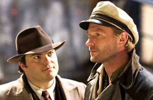 Jack Black as Carl Denham and Thomas Kretschmann as Captain Englehorn in Peter Jackson's King Kong