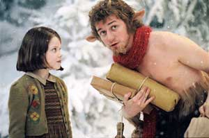 Georgie Henley as Lucy and James McAvoy as Mr Tumnus in The Lion, the Witch and the Wardrobe