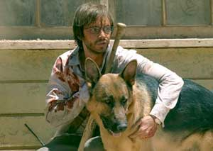 Aaron Stanford as Doug, with Beast