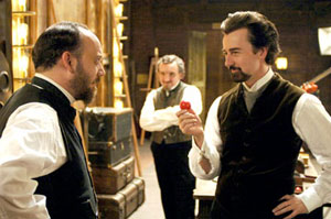Paul Giamatti as Inspector Uhl and Edward Norton as Eisenheim the Illusionist