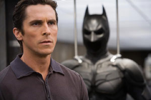 Christian Bale examines his 'silly batsuit'