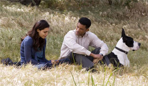 Will Smith and Rosario Dawson and Duke the dog in Seven Pounds