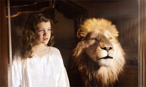 Georgie Henley as Lucy, with Aslan (voiced by Liam Neeson)