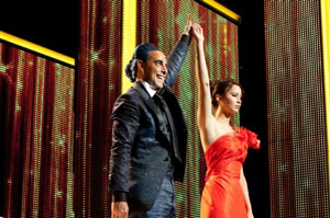 Stanley Tucci and Jennifer Lawrence play the game in The Hunger Games