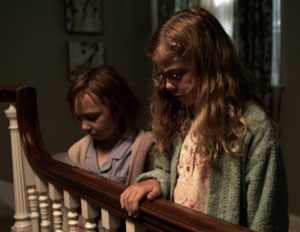Isabelle Nélisse as Lilly and Megan Charpentier as Victoria in Mama