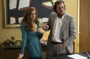 Amy Adams as Sydney/Edith and Christian Bale as Irv in American Hustle