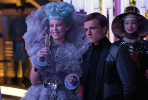 Elizabeth Banks as Effie and Josh Hutcherson as Peeta in The Hunger Games: Catching Fire