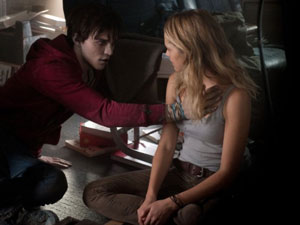 Nicholas Hoult as R and Teresa Palmer as Julie in Warm Bodies
