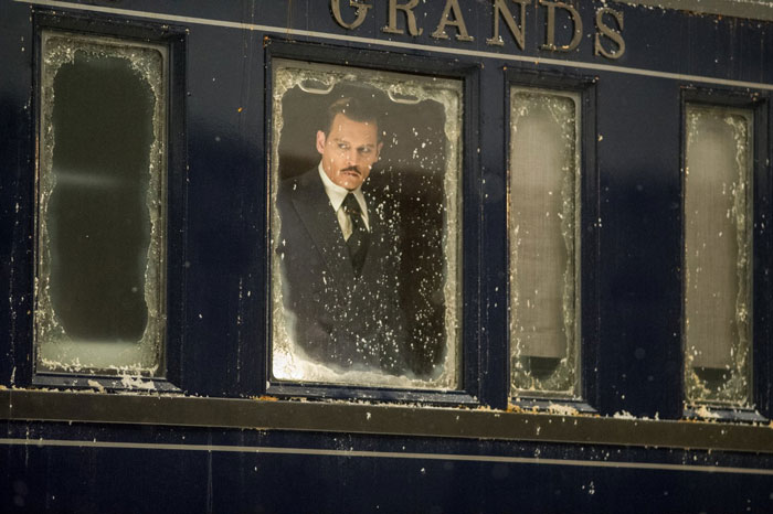Johnny Depp as Ratchett in Murder on the Orient Express
