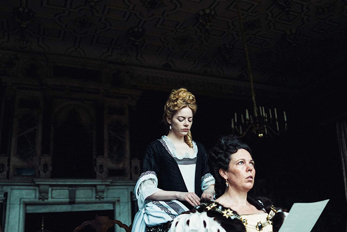 Emma Stone as Abigail Hill and Olivia Colman as Queen Anne in The Favourite