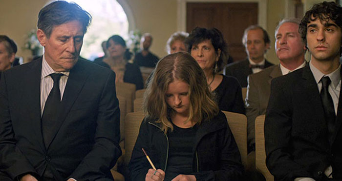 Stephen (Gabriel Byrne), Charlie (Milly Shapiro) and Peter (Alex Wolff) at the funeral