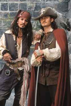 Johnny Depp and Orlando Bloom buckle their swashes. Phoar!