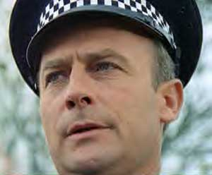 Edward Woodward as Sergeant Neil Howie