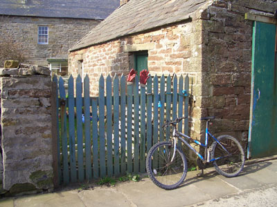 Bicycle and gloves in St Margaret's Hope, Orkney