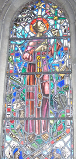 A stained glass window of St Francis at Rosslyn Chapel